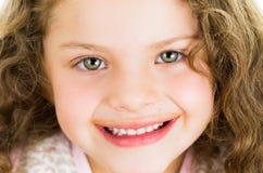 Cute little preschooler girl with chocolate milk Stock Photos
