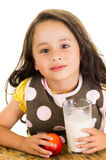 Cute little preschooler girl drinking a glass of Royalty Free Stock Image