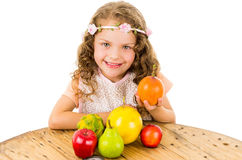 Cute little preschooler girl with fruits on the Royalty Free Stock Photo
