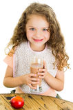 Cute little preschooler girl holding a glass of Stock Photography