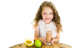 Cute little preschooler girl holding a glass of Stock Image