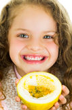 Cute little preschooler girl holding a passion Stock Image
