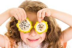 Cute little preschooler girl holding pitahaya Royalty Free Stock Photography