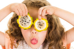 Cute little preschooler girl holding pitahaya Royalty Free Stock Photo