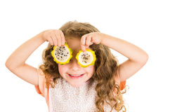Cute little preschooler girl holding pitahaya Royalty Free Stock Images