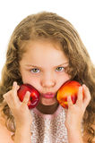 Cute little preschooler girl holding two peaches Stock Photos