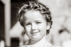 Cute little preschooler girl natural portrait on the sun Royalty Free Stock Photography