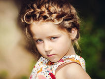 Cute little preschooler girl natural portrait on the sun Royalty Free Stock Images