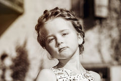 Cute little preschooler girl natural portrait on the sun Royalty Free Stock Image