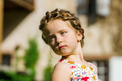 Cute little preschooler girl natural portrait on the sun Royalty Free Stock Photos