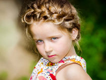 Cute little preschooler girl natural portrait on the sun Stock Images