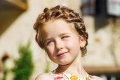 Cute little preschooler girl natural portrait on the sun Stock Photography