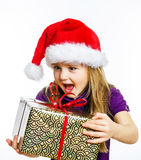 Cute little preschooler girl in red santa hat with gift box Stock Image