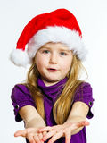 Cute little preschooler girl in red santa hat with gift box Stock Photography