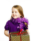 Cute little preschooler girl in red santa hat with gift box Royalty Free Stock Photo