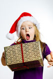 Cute little preschooler girl in red santa hat with gift box Stock Photo