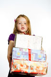 Cute little preschooler girl in red santa hat with gift box Stock Images