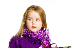 Cute little preschooler girl in red santa hat with gift box Royalty Free Stock Photography