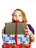Cute little preschooler girl in red santa hat with gift box Royalty Free Stock Photos