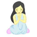 A Cute Little Pretty Girl Kneeling and Praying Stock Images