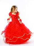 Cute little princess dressed in red  with crown on her head posi Stock Images