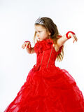 Cute little princess dressed in red  with crown on her head posi Stock Image