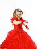 Cute little princess dressed in red  with crown on her head posi Royalty Free Stock Photography
