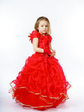 Cute little princess dressed in red dancing. Isolated on white b Stock Photos