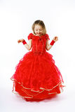 Cute little princess dressed in red dancing. Isolated on white b Stock Image