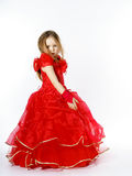 Cute little princess dressed in red dancing. Isolated on white b Stock Photography