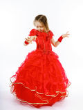 Cute little princess dressed in red dancing. Isolated on white b Royalty Free Stock Image