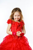 Cute little princess dressed in red dancing. Isolated on white b Royalty Free Stock Photo