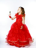 Cute little princess dressed in red isolated on white background Royalty Free Stock Images