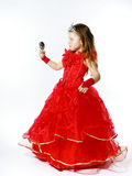 Cute little princess dressed in red isolated on white background Royalty Free Stock Photos