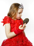 Cute little princess dressed in red isolated on white background Stock Photo