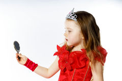 Cute little princess dressed in red  on white background Stock Photography