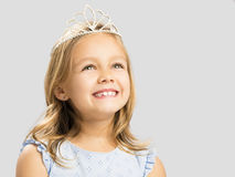 Cute little princess. Portrait of a cute happy little girl wearing a princess crown royalty free stock photo