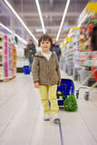 Cute little and proud boy helping with grocery shopping, healthy Royalty Free Stock Images