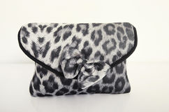 Cute little purse with grey tiger pattern and a bow. Stock Photography