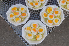 Cute little quail eggs cut into halve served on top of shredded cabbage Royalty Free Stock Images