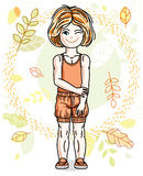 Cute little red-haired girl standing on background of autumn lan Stock Photography