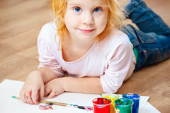 Cute little redhead girl painting. Stock Photography