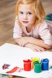 Cute little redhead girl painting. Royalty Free Stock Photography