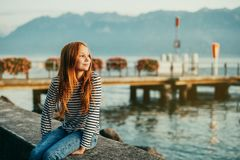 Outdoor fashion portrait of pretty little preteen girl Royalty Free Stock Images