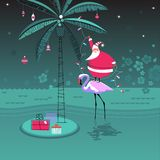 Warm wishes for this holiday season. Cute little Santa Claus stands on flamingo decorating palm tree with Christmas ornaments and garland lights. Tropical happy stock illustration