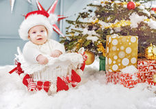 Cute little santa sitting in the wicker basket Royalty Free Stock Photos