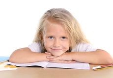 Cute little school girl happy on desk leaning in relax on book Royalty Free Stock Photos