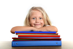 Cute little school girl happy on desk leaning in relax on book Stock Image