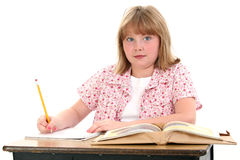 Cute Little School Girl Sitting in Desk with Books stock images