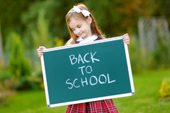 Cute little schoolgirl feeling excited about going back to school. Cute little schoolgirl feeling very excited about going back to school Royalty Free Stock Images
